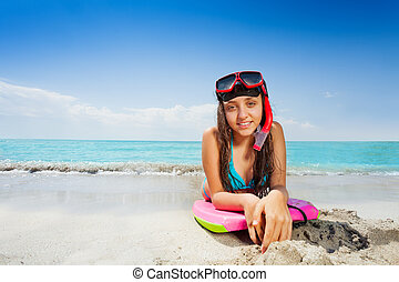 Girl on the board ready for swimming in sea