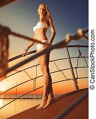 Girl on the bridge over pool