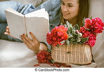 girl on the couch reading books
