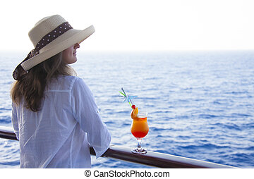 Girl on the deck drinking a cocktail