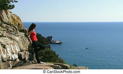 Girl on the edge of the cliff