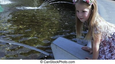 Girl on the edge of the fountain