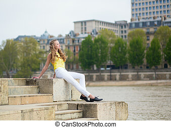 Girl on the embankment in Paris
