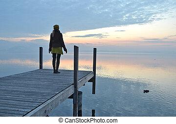Girl on the pier. Lake of Zug, Switzerland