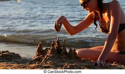 Girl on the Sea Builds a Sand Castle Antalya