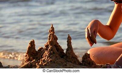 Girl on the Sea Builds a Sand Castle Antalya - On the sandy...