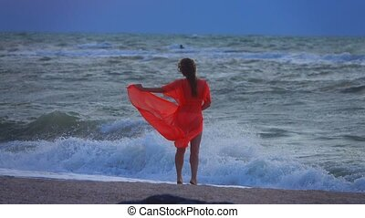 girl on the sea in a storm