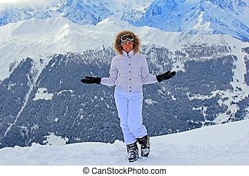 Girl  on the snow in mountains