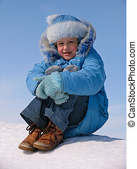 Girl on the snow under blue sky