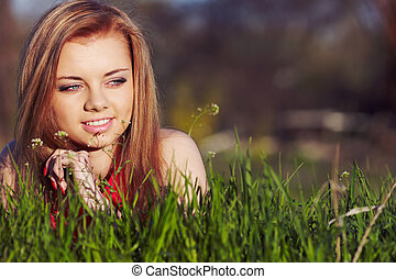 Girl on the spring grass