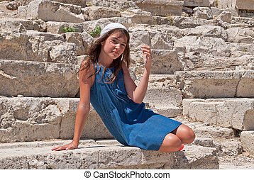 Girl on the stone.