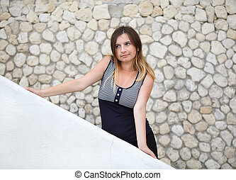 Girl on the wall background