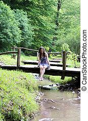 Girl on the wooden bridge