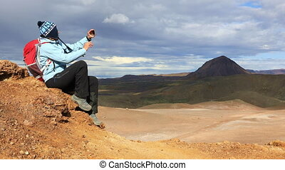 Girl on top with mobile phone - Girl sitting on top of a...
