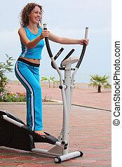girl on training apparatus outdoor full body