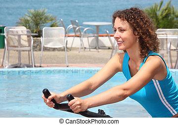 girl on training apparatus outdoor