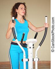 girl on training apparatus