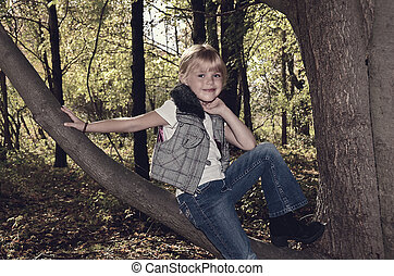 girl on tree branch