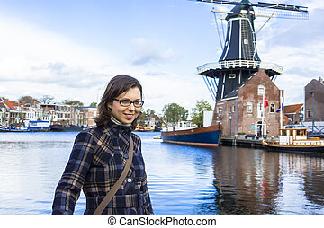 Girl on waterfront in Dutch town of Haarlem, the Netherlands