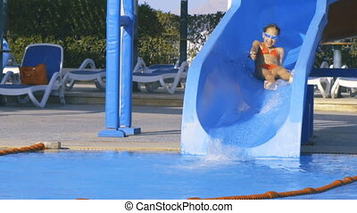 Girl on waterslide in aqua park pipe