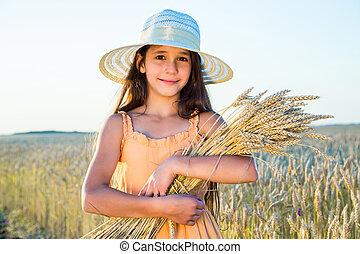 Girl on wheat field - Smiling girl with sheaf of wheat ...