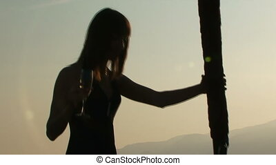 Girl on yacht - Silhouette of a girl standing at the bow...
