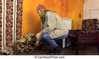 girl open stove door bask