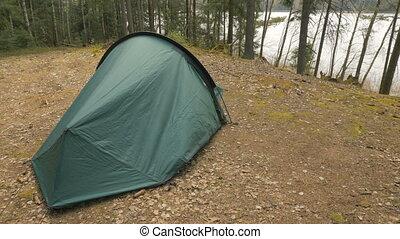 Girl open the tent in the forest