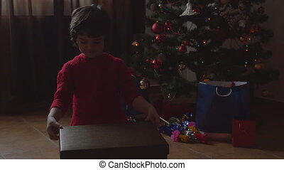 Girl opening the Christmas present