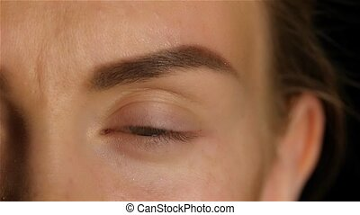 Girl opens her eyes and her eyes are very sore and swollen....