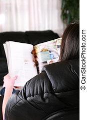 Girl or woman reading magazine