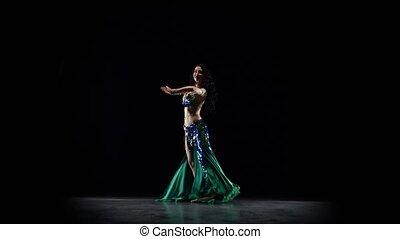 Girl oriental belly dancer. Black background - Beautiful...