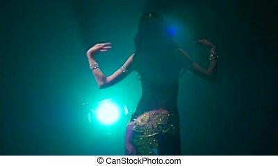 Girl oriental belly dancer. Smoke background. Slow motion....