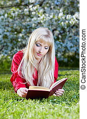 girl outdoors with book