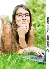 girl outside on laptop