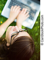 girl outside with laptop
