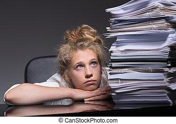 Girl overwhelmed by paperwork
