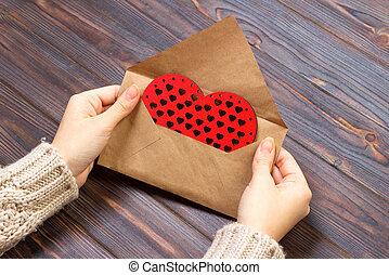 girl packs a love letter for Valentine's Day