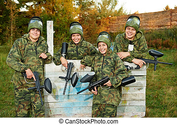 girl paintball player - Happy paintball sport player girl in...