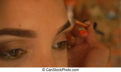 girl painted eyes dark saturated shades close-up - young...
