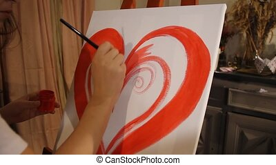 girl painting a red heart