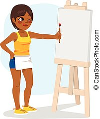 Young African American girl standing painting on white blank canvas