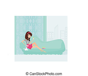 girl painting nails on the sofa