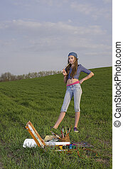 Girl painting on the meadow