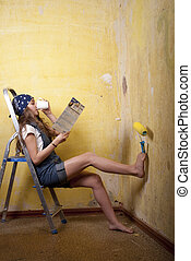 girl painting on the wall