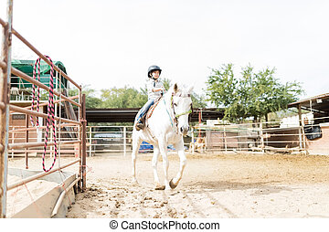 Girl Participating In Equine Therapy Program