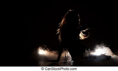 girl passionately dancing, silhouette