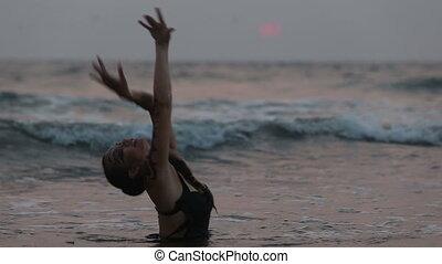 Girl Performers dance acrobatic stunts in the water - Girl...