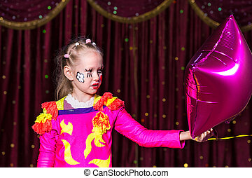 Girl performing with vivid pink theatrical costume