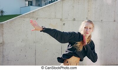 Girl Performs Modern Hip Hop Dance on the Streets - A young...